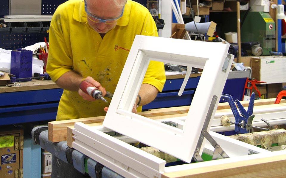 One of our production team working on a timber window
